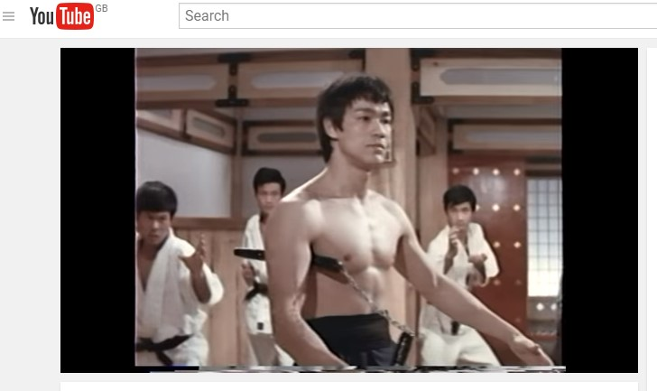 Bruce Lee with nunchuku from movies